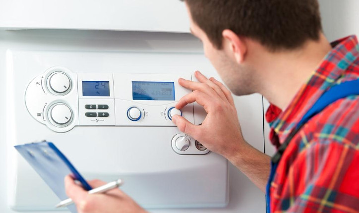 http://www.dreamstime.com/royalty-free-stock-photography-technician-servicing-heating-boiler-gas-hot-water-image38894917